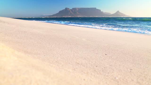 Ocean laps white beach Table Mountain video