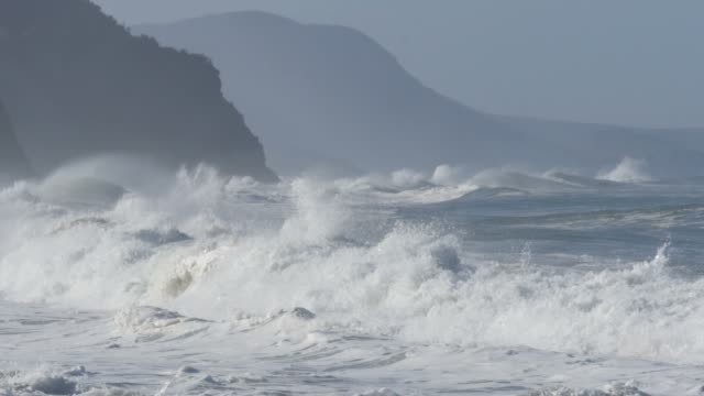 ocean spray from crashing waves during stormy weather out at sea - ciclone video stock e b–roll