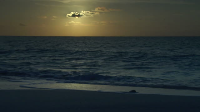 ocean sun and small cloud (low key) video