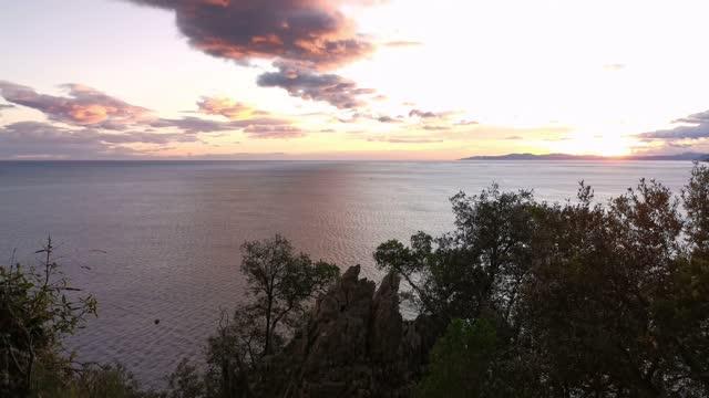 Ocean ââviews at sunrise from a stair path on a cliff