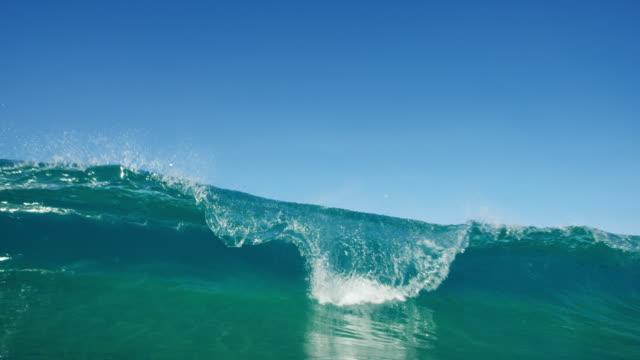 Ocean Wave Beautiful blue ocean wave breaking in slow motion giant fictional character stock videos & royalty-free footage