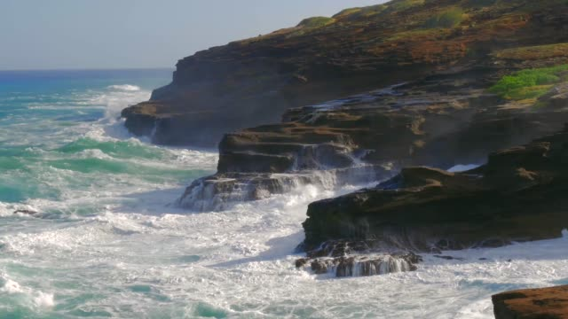 Ocean Waves Hawaii Shoreline Scenic Ocean waves and the rugged shore of Hawaii big island hawaii islands stock videos & royalty-free footage