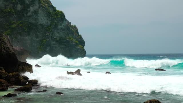 Ocean waves hitting Tembeling Coastline at Nusa Penida island, Bali Indonesia video