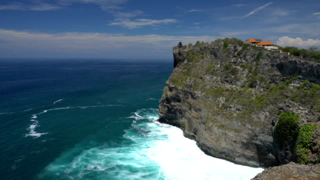 Ocean waves splashing over volcanic rocky shore video