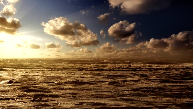 Ocean with nice sky timelabs and slow motion. video