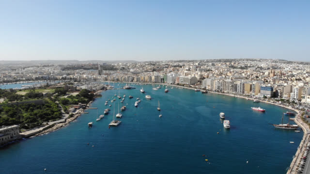 MALTA – October 2018 : Aerial shot of Sliema cityscape on a sunny day with harbor and boats in view Aerial shot of Sliema cityscape on a sunny day with harbor and boats in view malta stock videos & royalty-free footage