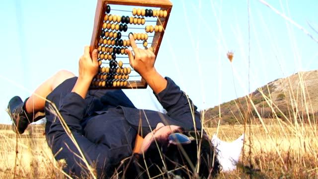 odd woman in black playing with abacus at nature - abakus bildbanksvideor och videomaterial från bakom kulisserna