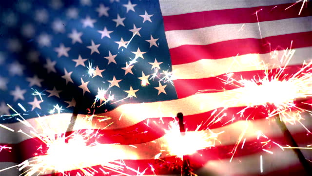 4 of july independence day concept with sparkler and usa flag rippled - luglio video stock e b–roll