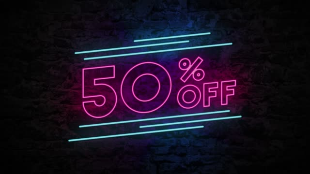 50% off neon sign on brick background 4k animation - sales video stock e b–roll