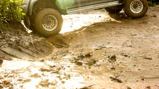 off road car with muddy road. video