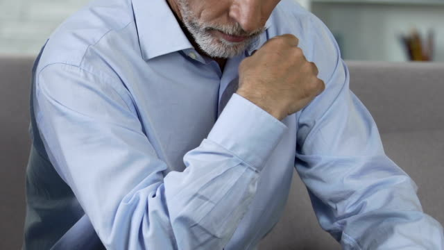 Offended man sitting at office, reluctant to retire from work, aging issues video