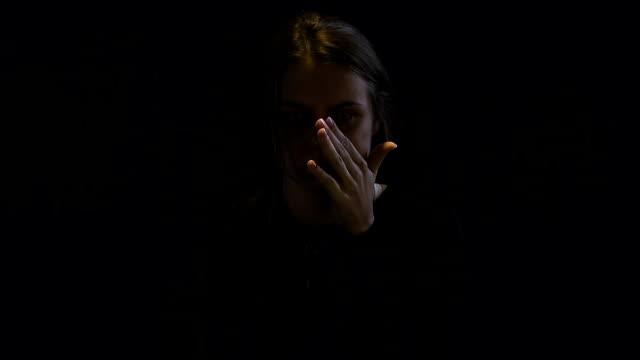 vídeos y material grabado en eventos de stock de mujer ofendida limpiar lágrimas, decide cambiar su vida, ayudar a adictos - human trafficking