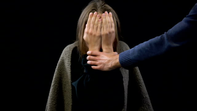 Offender checking domestic violence female victim hand sharply, marital abuse Offender checking domestic violence female victim hand sharply, marital abuse human trafficking stock videos & royalty-free footage
