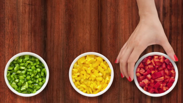 Offering bowls with diced bell peppers video