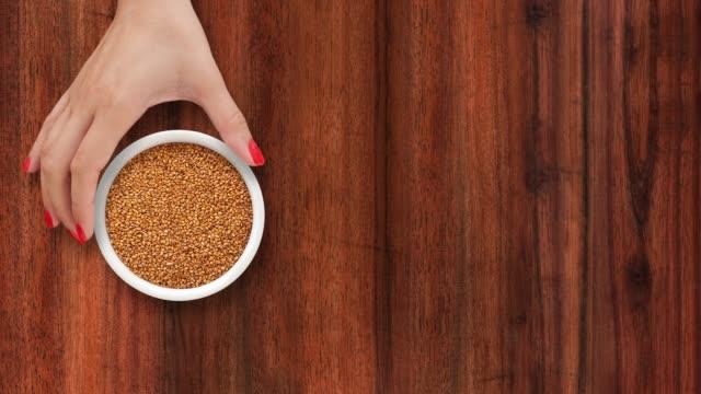 offering brown sesame seeds - sesamo video stock e b–roll