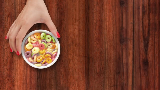 Offering multicolored cereal rings with milk video