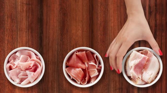 Offering sliced hams video