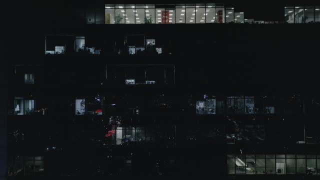Office building facade at night video