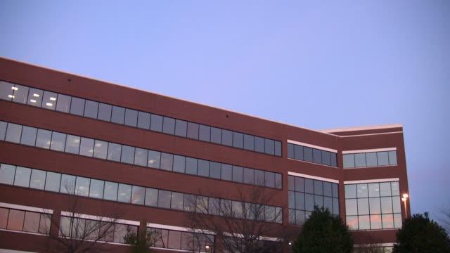 Office Building Tilt Tilt shot of office building. facade stock videos & royalty-free footage