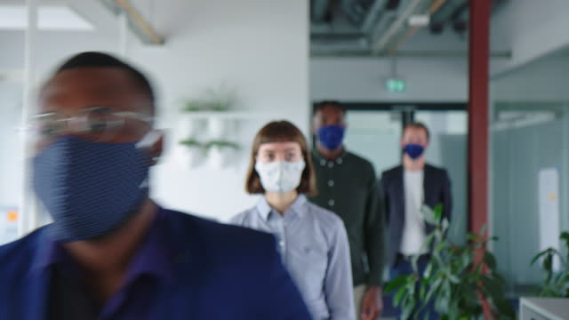 Office employees going through a temperature checkpoint