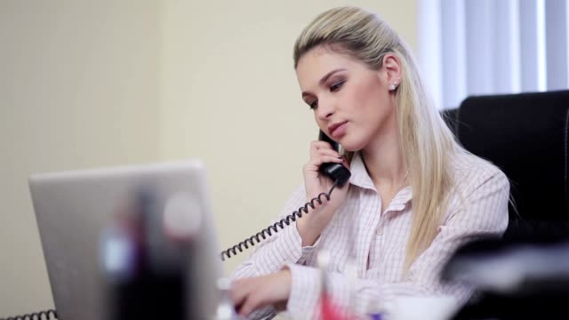 Office manager answering the call video