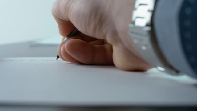 Office Manager Writing A Report At The Office Desk video