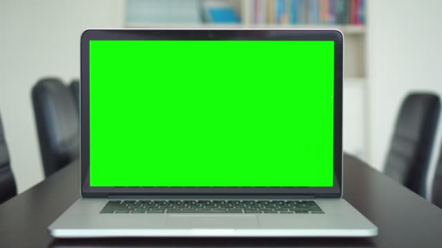 office shot of green screened laptop screen on desk - dolly shot video stock e b–roll