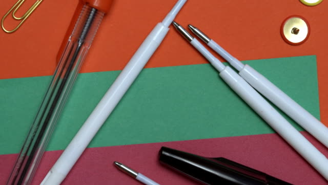 Office supplies over colorful paper video