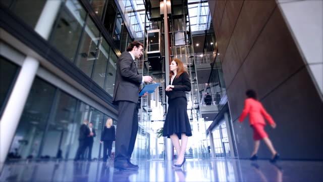 Office team in large atrium video