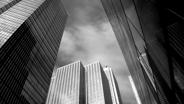 office towers. timelapse. black and white. - black and white architecture stock videos & royalty-free footage
