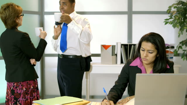 office worker being disturbed by other people in the background video