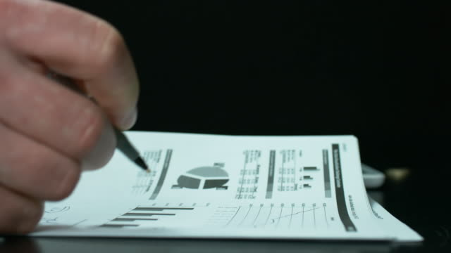 Office Worker Checking Documentation With A Pen. video