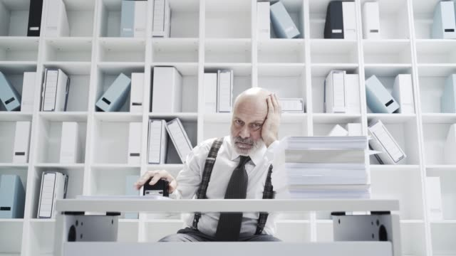 office worker doing a boring repetitive job - ripetizione video stock e b–roll