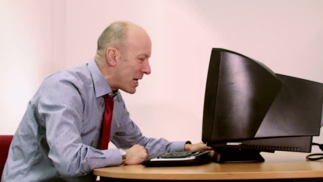 Office worker loses it with computer video