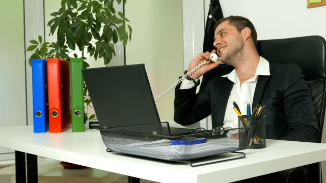 office worker or manager talking on the phone in the office - travel agent stock videos and b-roll footage