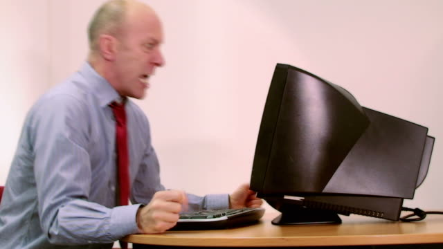 Office worker stressed with computer video
