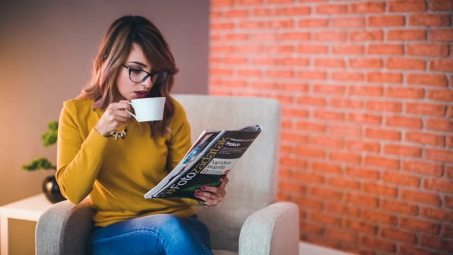 Office worker with coffee and magazine video