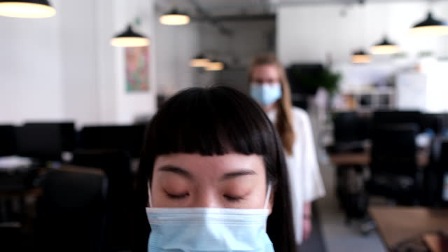Office workers going through temperature checks