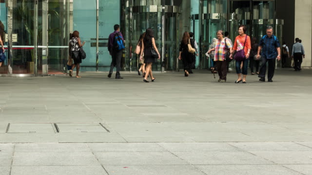 Office workers walk to work in financial and business district Singapore. video