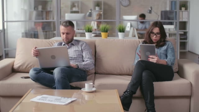 Office Workers with Tech Gadgets video