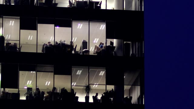 Office workers working late evening video