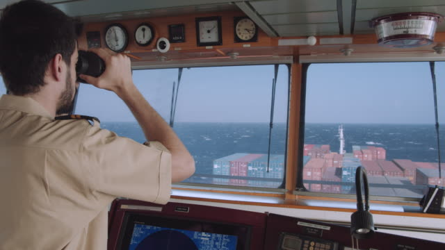 Officer is checking the route with binoculars