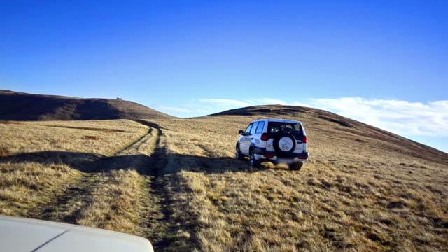 Off-road driving through Macedonian mountain plateau at high peak video