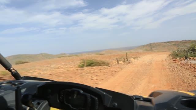 Off-road UTV Aruba tour. Amazing stone desert landscape and blue sky.  North coast. Natural beauty of Aruba.