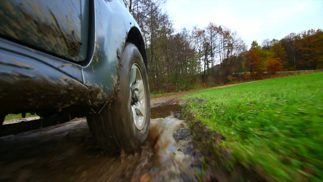 Off-Road Vehicle Driving Through Mud POV video