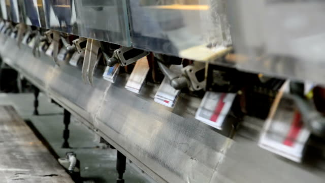 offset magazine, brochure stitching process. loopable - lithograph stock videos & royalty-free footage