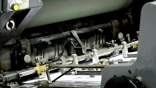 offset printing press, conveyor belts deliver paper to machine drum - lithograph stock videos & royalty-free footage