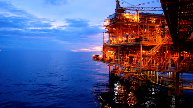 Offshore oil and gas platform, Central processing platform in sunset time produced raw gases and condensate or crude oil then sent gas to onshore refinery