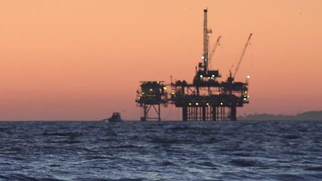 Offshore oil drilling platform at dusk