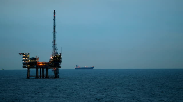 offshore oil rig at dusk - gulf coast states stock videos & royalty-free footage